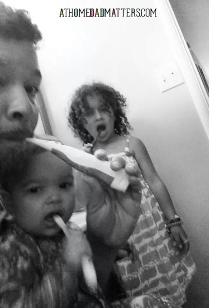 dad and daughter brushing teeth SAHD